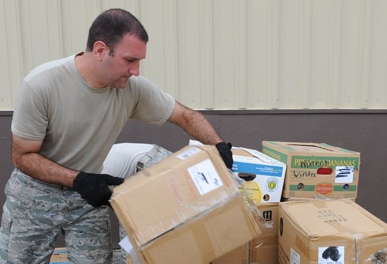 GOLDSBORO, N.C. -- Staff Sgt. Justin Smilo organizes pallets of donated food and clothing at the MERCI Mission Center Aug. 20, 2010. The pallets will go to Afghanistan for distribution during humanitarian missions. Sergeant Smilo, 4th Logistic Readiness Squadron air terminal operations, hails from Easton, Conn. (U.S. Air Force photo/Senior Airman Gino Reyes)