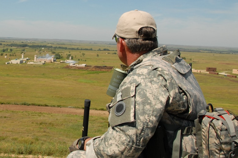 Lt. Col. Gary Nash watches as aircrews bomb a building on which he has just directed an air strike. According to him, a JTAC's greatest responsibility is to eliminate enemy threat while weighing the risk to friendly forces.