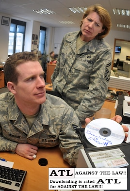 SPANGDAHLEM AIR BASE, Germany - According to the 52nd Fighter Wing Office of the Staff Judge Advocate, downloading media onto a government system violates Article 92 of the Uniformed Code of Military Justice and failure to obey an order or regulation. Punishment for this includes confinement for up to six months. (U.S. Air Force photo illustration/Senior Airman Nick Wilson)