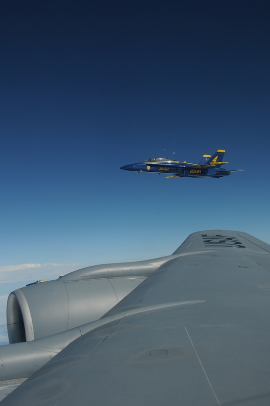 An F/A-18 Hornet belonging to the United States Navy's Flight Demonstration Squadron, the Blue Angels, forms up on the wing of a KC-135R Stratotanker over the Eastern United States on August 25, 2010. The tanker aircraft and crew are from the 157th Air Refueling Wing at Pease Air National Guard Guard Base, New Hampshire. The Blue Angels are headed to the 2010 Boston New-England Airshow  at Pease International Airport on August 28th-29th 2010. Although the NH Air National Guard won't be hosting the airshow, they will be providing logistical support to the Blue Angels and other military aircraft. (U.S. Air Force photo/Staff Sgt. Curtis J. Lenz)