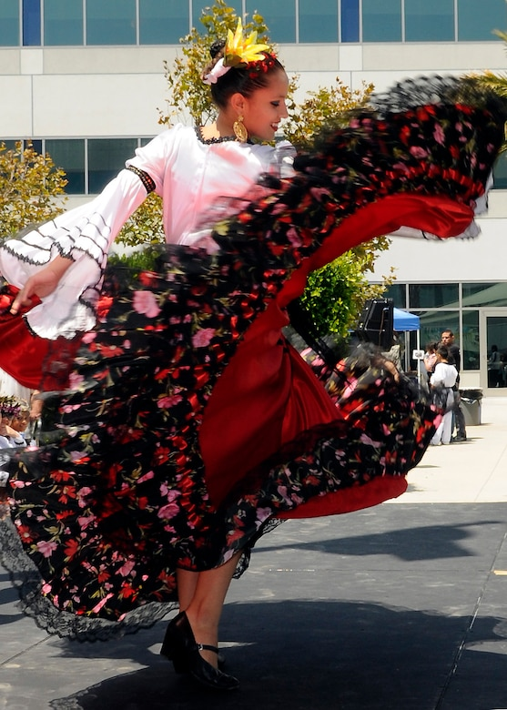 A dancer performs a traditional Northern Mexican dance influenced by German dance styles during one of the many cultural performances at the Space and Missile Systems Center's first Diversity Day celebration in the Schriever Space Complex courtyard,  Aug. 4.    (Photo by James Gordon)
