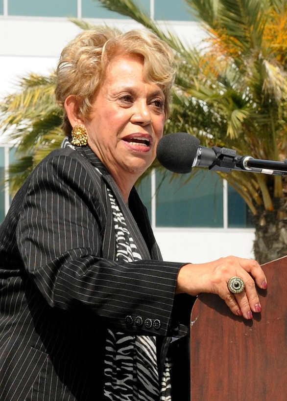 """Lupe Ontiveros, award-winning actress, producer, community activitist and visionary, speaks at the opening procession of the Space and Missile Systems Center's first Diversity Day celebration, in the Schriever Space Complex courtyard, Aug. 4.  The theme for Diversity Day was, """"One World, One Team, One Mission,"""" drawing from the premise that diverse backgrounds and experiences add value to the team focus of delivering space power to today's warfighter, which is the mission of SMC.  (Photo by James Gordon)"""