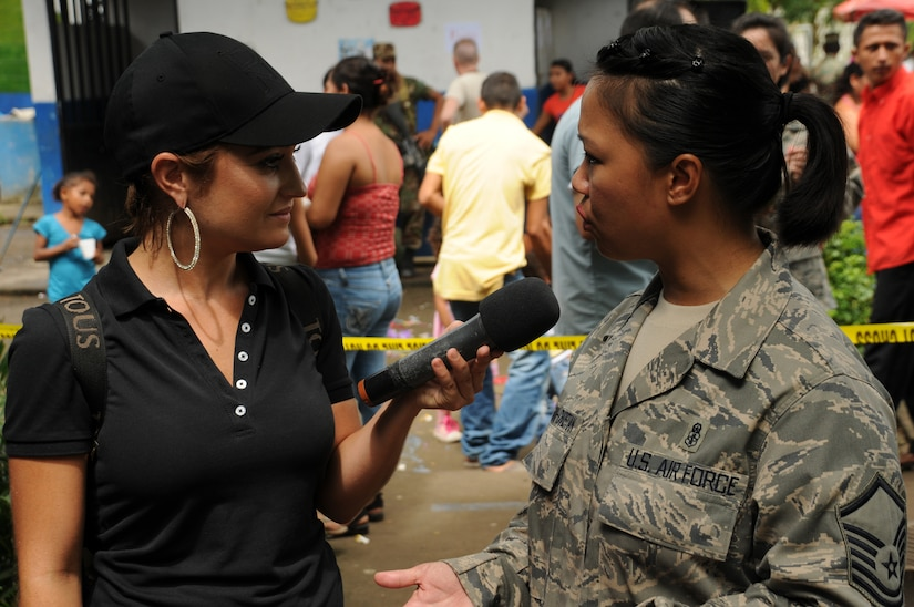 "EL PICHICHE, El Salvador -- Maria Elisa Parker, the host of ""Viva La Mañana"" in El Salvador, interviews Master Sgt. Judy Santa Ana-Christian, with the Joint Task Force-Bravo Medical Element, during the medical civic action program here Aug. 24. Viva La Mañana is a program similar to ""Good Morning America"" in the U.S. (U.S. Air Force photo/Tech. Sgt. Benjamin Rojek)"