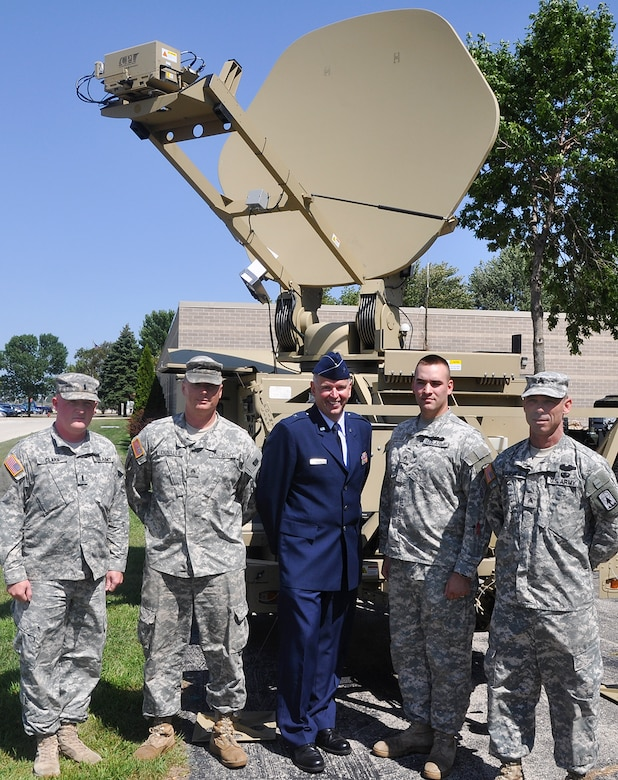 Brig. Gen. John E. McCoy, the assistant adjutant general for Air, stands beside Soldiers assigned to the 357th Network Support Company, 157th Maneuver Enhancement Brigade, Two Rivers, Wis., at the 128th Air Refueling Wing, Milwaukee, Wis., on Friday, August 27, 2010.  The service members participated in a tour of the air wing for the American Legion's National Security Commission.  (U.S. Air Force photo by Staff Sgt. Jeremy Wilson / Released)