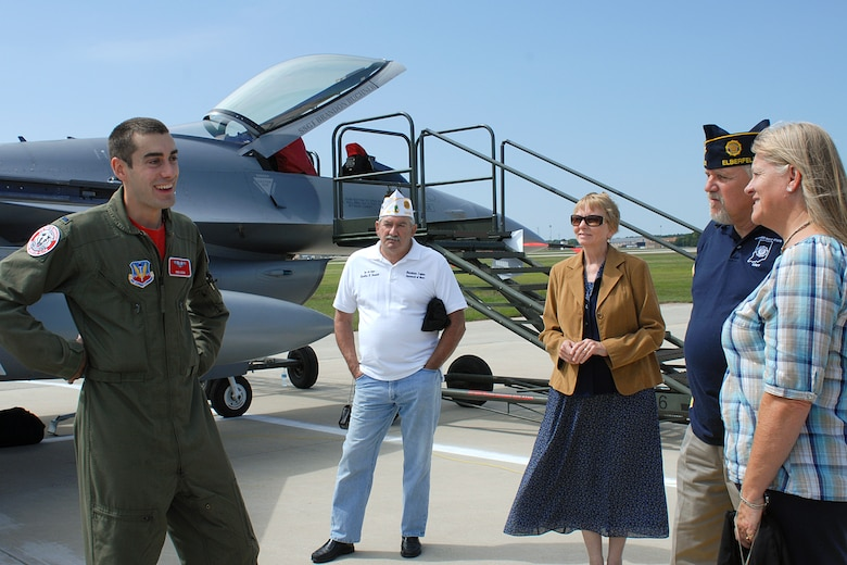 First Lieutenant Mike Koob, an F-16C pilot assigned to the 115th Fighter Wing, Madison, Wis., answers questions regarding his aircraft during an on-base tour at the 128th Air Refueling Wing, Milwaukee, Wis., on Friday, August 27, 2010.  The tour involved 48 members of the American Legion National Security Commission and involved other military assets on display.  (U.S. Air Force photo by Master Sgt. Kenneth Pagel / Released)