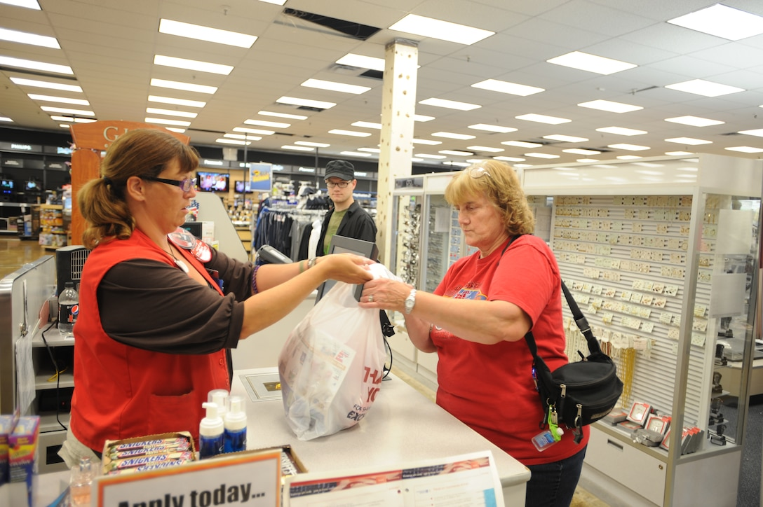 Lari Sasser, Army & Air Force Exchange Service cashier, helps Bev Ackley checkout Aug. 27 at the Base Exchange on Grand Forks Air Force Base, N.D. (U.S. Air Force photo by Staff Sgt. Suellyn F. Nuckolls)