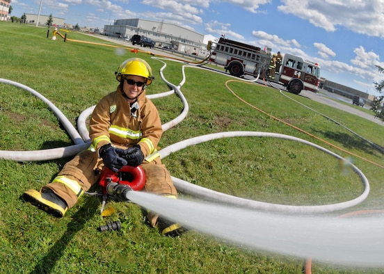 The Niagara Falls Reserve Station Fire Department practice spraying hoses, August 27, 2010, Niagara Falls Air Reserve Station, Niagara Falls, N.Y. Through constant training and practice the Niagara Falls Air Reserve Fire Department can stay prepared for any contingency.  (U.S. Air Force photo by Staff Sgt. Joseph McKee)