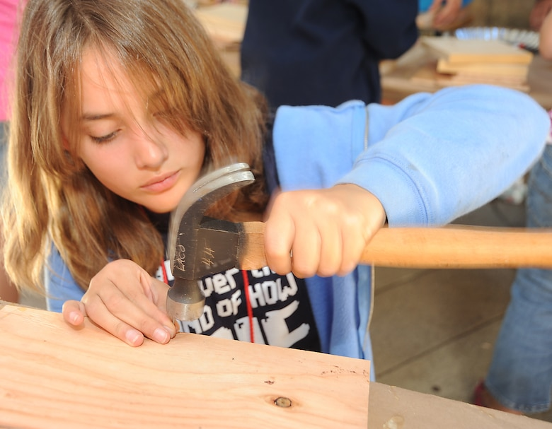 Ashley Anderson builds a bird feeder at Camp Seeley, June 30.  Approximately 25 kids ranging from 9 years and up from the Los Angeles Air Force Base Youth Center spent a week at the camp,  located  in the Angeles National Forest.  (Photo by Joe Juarez)