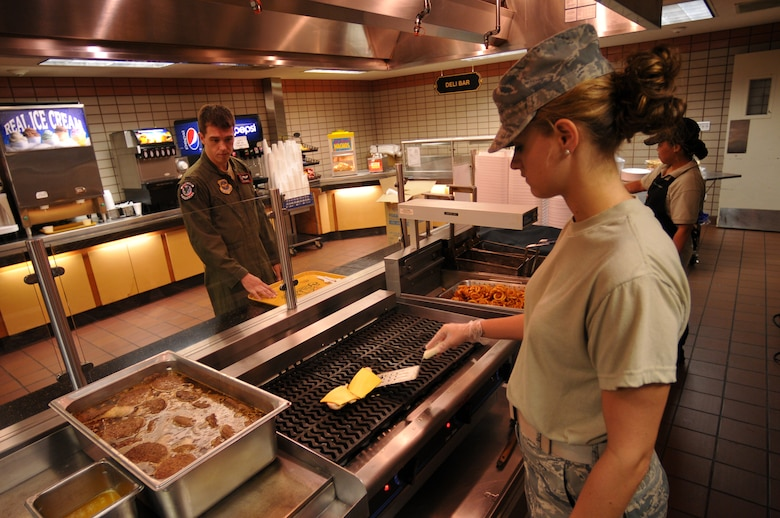 Airman 1st Class Caitlin Taylor, 115th Force Support Squadron, prepares a cheeseburger for a waiting patron at the dining facility at Eielson AFB, Alaska Aug. 18. Taylor deployed to Eielson in support of the 115th Fighter Wing out of Madison, Wis. (Wisconsin Air National Guard photo by Tech Sgt. Ashley Bell)