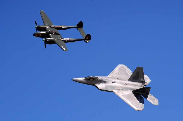 OFFUTT AIR FORCE BASE, Neb. - A heritage flight Aug. 28 that included a P-38 Lightning of the Army Air Corps and an F-22 Raptor demonstrates the proud heritage of military aviation over the past 60 years. The 2010 Defenders of Freedom Open House and Airshow included this and many other aerial demonstrations as well as ground shows and static aircraft displays. U.S. Air Force photo by Josh Plueger