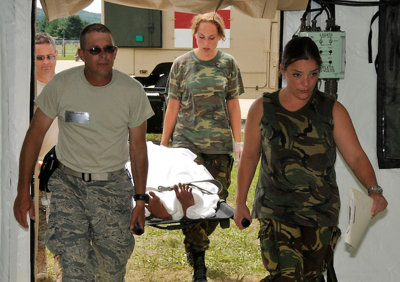 Tech. Sgt. McCammon (front left) and Tech. Sgt. Majors (back left) along with two Dutch Medics transport victim to staging area. Photo by Senior Master Sgt. John Chapman