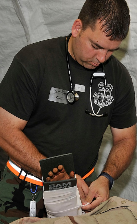 Capt. Martin splints an arm in the Emergency dept of the EMEDS.  Photo by Master Sgt. John Day
