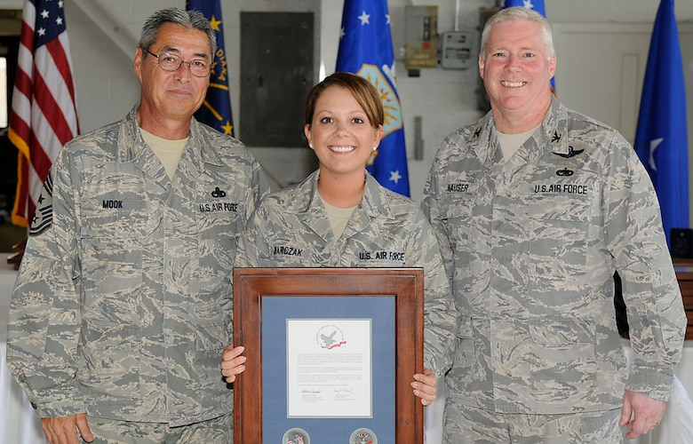 Chief Master Sgt. Henry Mook, Tech. Sgt. Amberlee Marczak and Col. Jeff Hauser.  Photo by Master Sgt. John Day