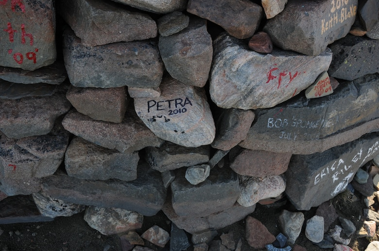 Thirty-three Airmen from the 821st Support Squadron at Thule Air Base, Greenland, hiked up the 724-foot high Thule landmark, Mount Dundas, Aug. 23. In keeping with tradition, Airmen wrote their names on rocks they carried from the bottom and placed them in a pile that marks all of those who have braved the Mount Dundas climb. (U.S. Air Force photo/Master Sgt. Petra Wright)