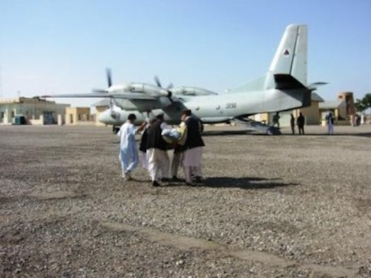 KONDUZ, Afghanistan - A burn victim is loaded onto an Afghan Air Force An-32 aircraft to transport them to Kabul, Afghanistan.  (U.S. Military photo/RELEASED