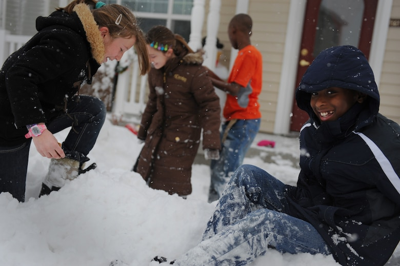 MOUNTAIN HOME AIR FORCE BASE, Idaho -- Ten-year-old Dajure Hunter laughs after falling in a pile of snow in base housing Dec. 1. The base received over three inches of snow in the last 12 hours. (U.S. Air Force photo by Staff Sgt. Gina Chiaverotti-Paige)