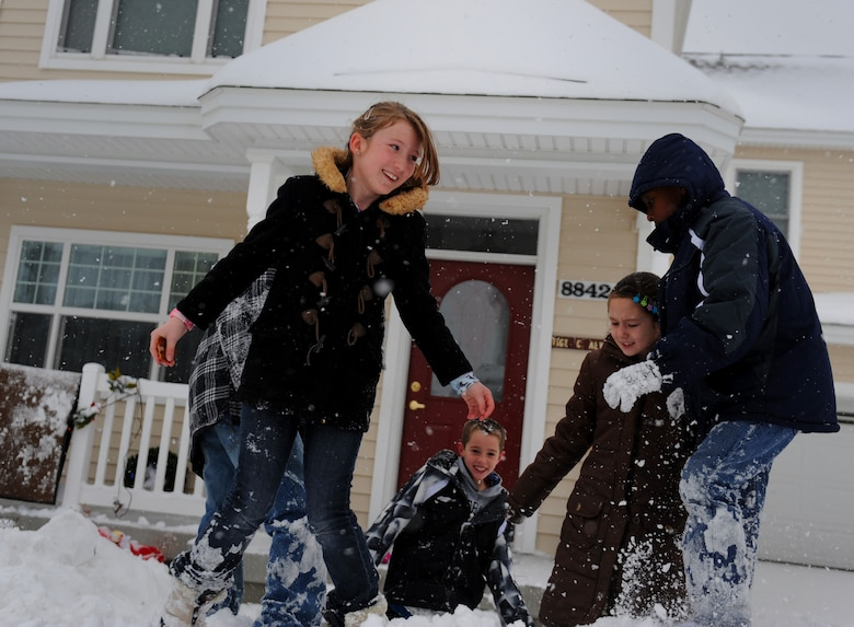 MOUNTAIN HOME AIR FORCE BASE, Idaho -- Children play in the snow in a base housing subdivision Dec. 1.  The base and local schools were closed due to the excessive accumulation of snow over the last 12 hours. (U.S. Air Force photo by Staff Sgt. Gina Chiaverotti-Paige)