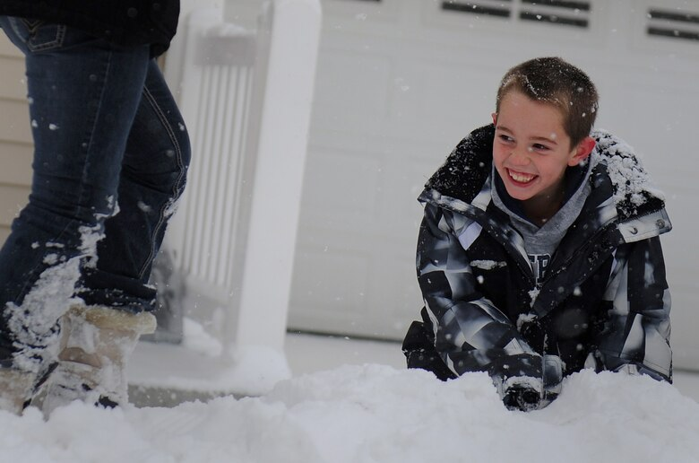 MOUNTAIN HOME AIR FORCE BASE, Idaho -- Nine-year-old Cody Alvarado, son of Tech Sgt. Christopher Alvarado, 366th Component Maintenance Squadron, plays in the snow in base housing Dec. 1. The base and local schools were closed due the inclement weather. (U.S. Air Force photo by Staff Sgt. Gina Chiaverotti-Paige)
