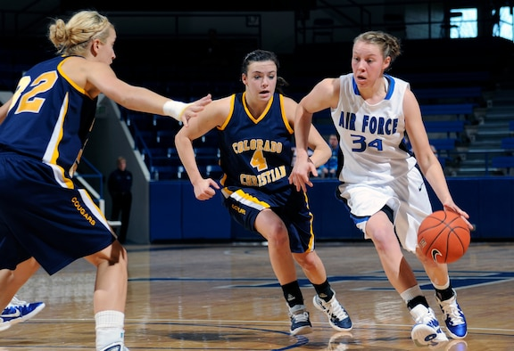 Air Force sophomore forward Kelsey Berger drives past Colorado Christian's Christina Whitelaw during the Falcons' match against the Tigers at the Air Force Academy's Clune Arena Nov. 28, 2010. Berger, a native of Mentor, Ohio, scored eight points in the Falcons' 68-58 win. (U.S. Air Force photo/Megan Davis)