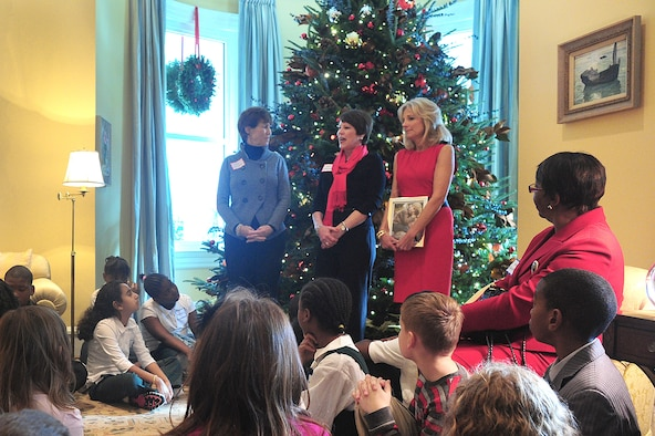 Cheryl McKinley (center) talks to children of National Guard families invited to take part in a holiday tree-trimming event Dec. 1, 2010, at the official residence of the vice president. During the event, children made cards for servicemembers and ornaments that will be on display at the residence throughout the holiday season. Standing with Mrs. McKinley are Dr. Jill Biden (right), the wife of Vice President Joe Biden; and Shelia Casey, the wife of Army chief of staff Gen. George W. Casey Jr. Mrs. McKinley is the wife of Air Force Gen. Craig R. McKinley, the chief of the National Guard Bureau. (U.S. Army photo/Sgt. 1st Class Jon Soucy)
