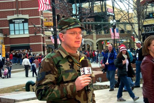 Tech. Sgt. Sterling Poulson, the Public Affairs Non-Commissioned Officer in Charge for Utah Air National Guard State Headquarters, gives a live weather report wearing his uniform during the 2002 Olympic Games in Salt Lake City. Sergeant Poulson is a traditional Air Guardsman as well as a local weatherman at KUTV 2News in Salt Lake City. U.S. Air Force courtesy photo (RELEASED).