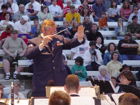 Tech. Sgt. Sterling Poulson, the Public Affairs Non-Commissioned Officer in Charge for Utah Air National Guard State Headquarters, conducts the annual Armed Forces Day concert in 2003. Sergeant Poulson is a traditional Air Guardsman as well as a local weatherman at KUTV 2News in Salt Lake City, Utah. Sergeant Poulson has a strong interest in music, and he founded the Choral Arts Society of Utah in 1987. As the music director of this 100-voice choir, he collaborated several times with the Utah Guard's 23rd Army Band for events like the Armed Forces Day concert. (U.S. Air Force photo by Master Sgt. Pat Valdez RELEASED)
