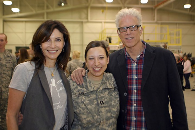 JOINT BASE ELMENDORF RICHARDSON, Alaska -- Capt. Amy Slinker, commander of the Alaska Army National Guard's 134th Public Affairs Detachmen, poses for a photo with Mary Steenburgen and Ted Danson during a meet and greet event held Nov. 6. Photo by Maj. Guy Hayes, Alaska National Guard Public Affairs Office.