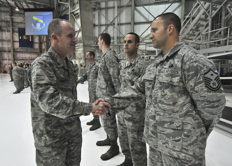 Adjutant General for the State of Wisconsin, Brigadier General Donald P. Dunbar, greets Maintenance Squadron First Sergeant, Master Sgt. David Roth, prior to the Commander's Call Sunday, December 05, 2010. U.S. Air Force photo by Staff Sgt. Nathan T. Wallin / released