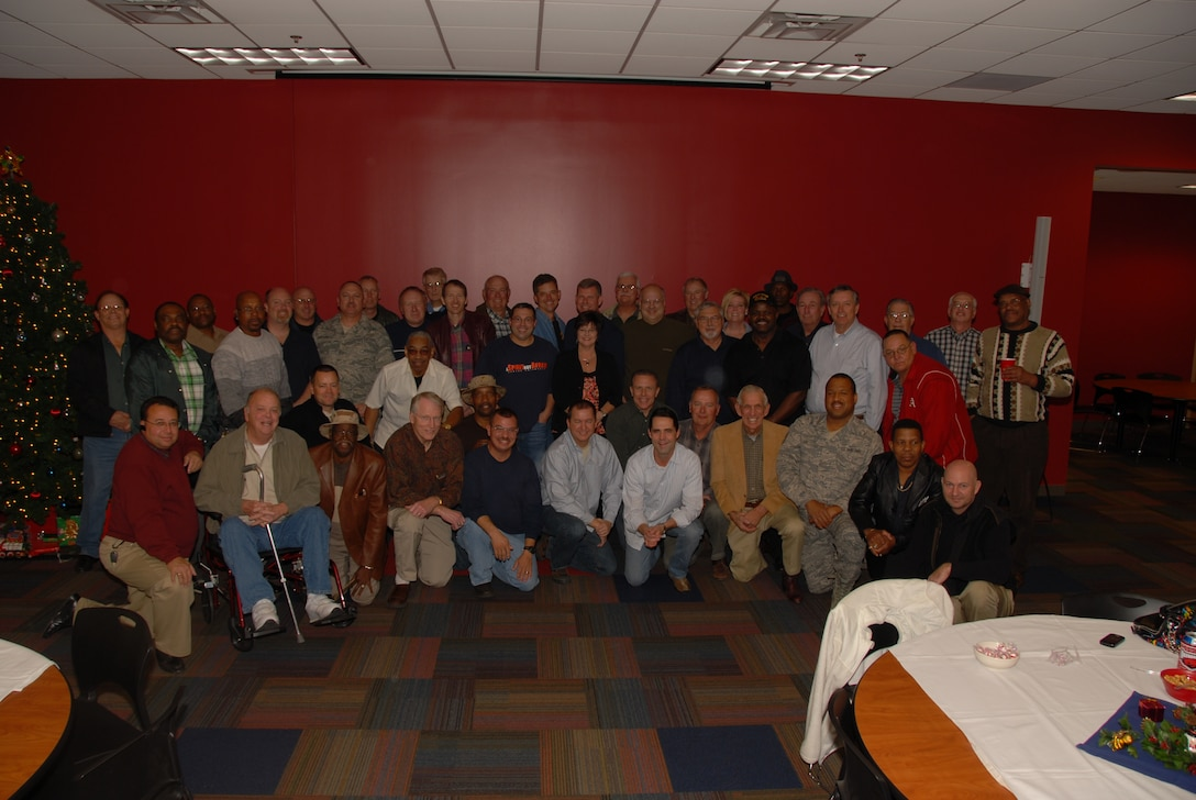 Former members of the 164th Aerial Port Squadron pose for a group picture during their 20 year Desert Storm Deployment Reunion.