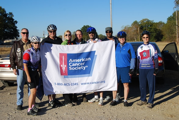 Col Harry Montgomery and members of the 164th Airlift Wing Bike Team pose during the First Annual Sherry Boyer Simmons Memorial Bike Ride.