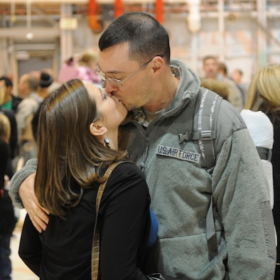 Tech. Sgt. Randon Beckstead kisses his wife after returning from a deployment to Southeast Asia, November 18, 2010, at the Utah Air National Guard Base in Salt Lake City. Sergeant Beckstead is a member of the 109th Air Control Squadron who was deployed for six months. (U.S. Air Force photo by Master Sgt. Gary J. Rihn)(RELEASED)