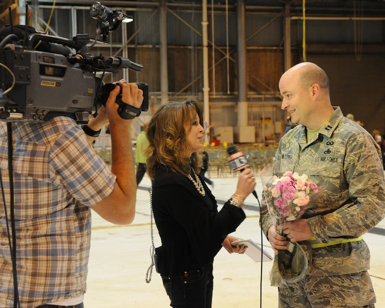 Capt. David Mulder is interviewed for a local TV station while he waits for his wife, Master Sgt. Cate Mulder, to arrive at the Utah Air National Guard Base in Salt Lake City, Utah, on November 18. Master Sgt. Mulder is a member of the 109th Air Control Squadron who spent six months deployed to Southeast Asia. (U.S. Air Force photo by Master Sgt. Gary J. Rihn)(RELEASED)
