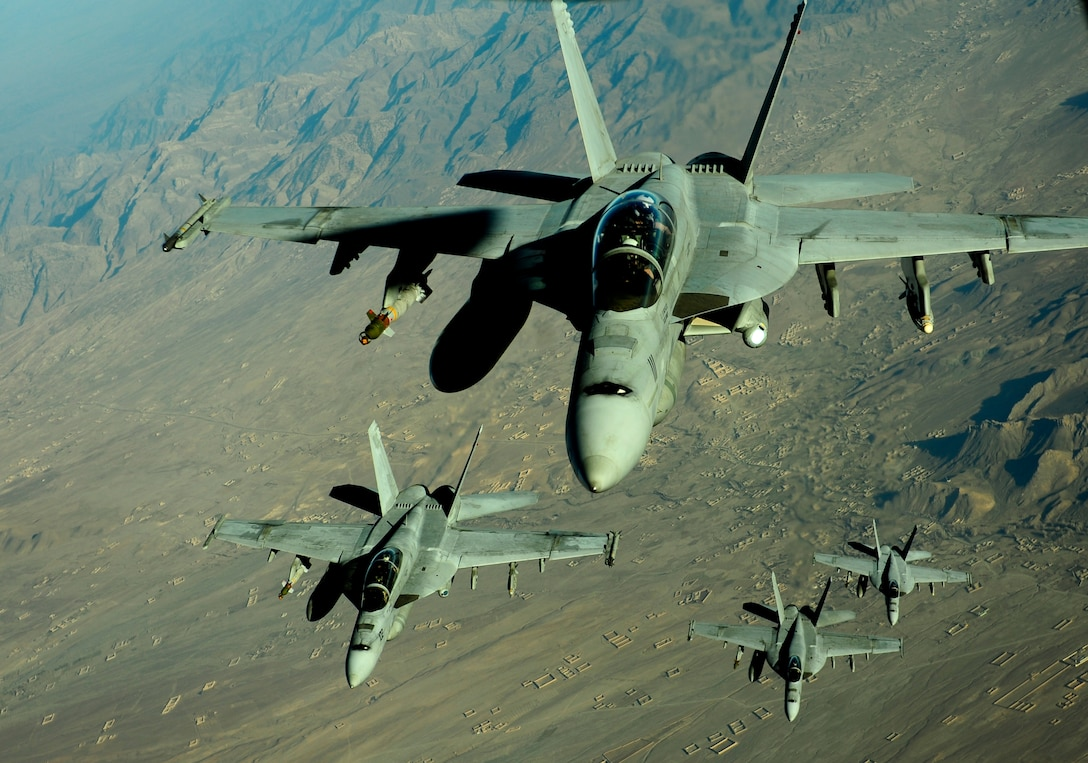 A KC-10 Extender aircraft assigned to the 908th Expeditionary Air Refueling Squadron prepares to supply fuel to four Navy F/A-18 Hornet aircraft over the mountains of Afghanistan on Nov. 25, 2010, during air refueling mission. The KC-10 Extender and the Airmen who fly them operate from a non-disclosed base in Southwest Asia. (U.S. Air Force Photo/Staff Sgt. Andy M. Kin)