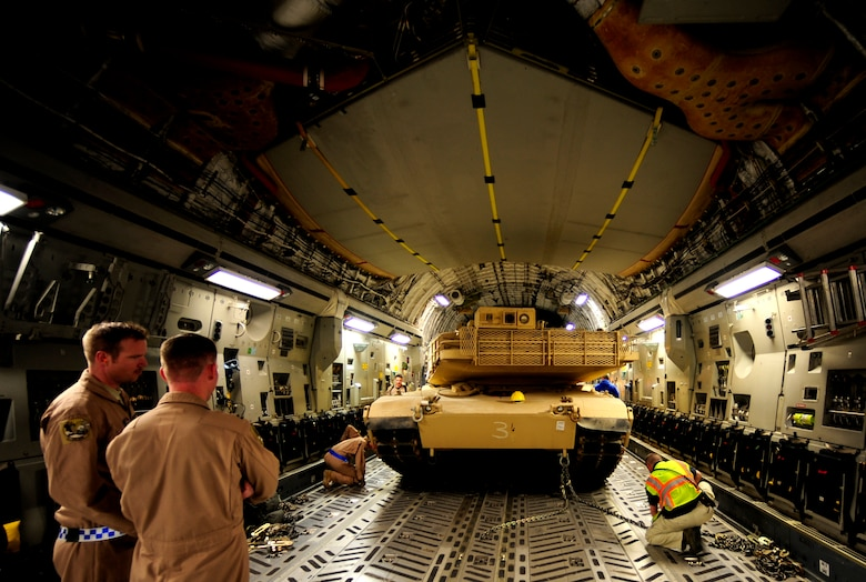A C-17 Globemaster III aircraft crew assigned to the 816th Expeditionary Airlift Squadron (EAS) loads a Marine Corps M1A1 Abrams tank for aerial transport to Afghanistan in support of Operation Enduring Freedom on Nov. 28, 2010. The 816th EAS is an airlift unit assigned to an undisclosed location in Southwest Asia. (U.S. Air Force Photo/Staff Sgt. Andy M. Kin)
