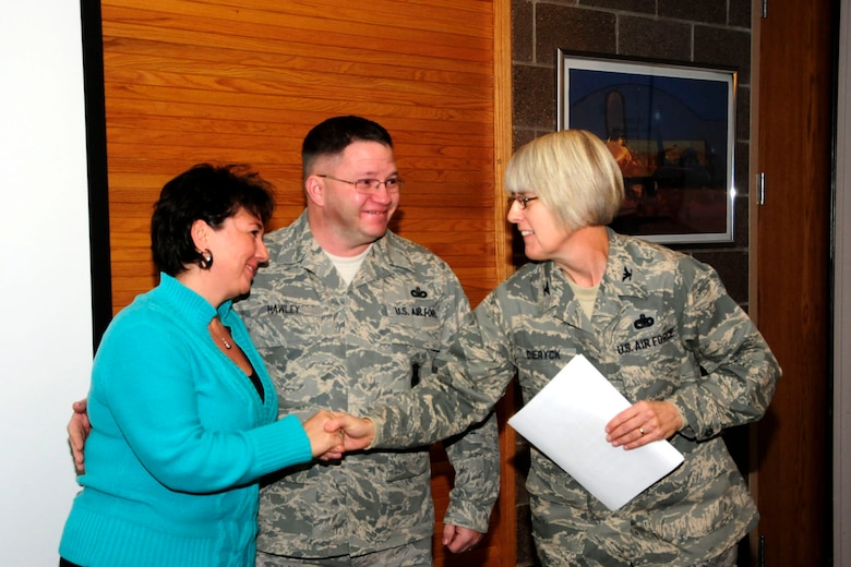 U.S. Air Force Master Sgt. William Hawley (center) and Mrs. Hawley (left) were congratulated by Colonel Penny Dieryck during the Wing Commander's Call at the 148th Fighter Wing, Minnesota Air National Guard base,  in Duluth, Minn. on December 05, 2010.  Master Sgt. Hawley was awarded the 2010 Air National Guard Security Forces Senior Noncommissioned Officer of the Year award.  (U.S. Air Force Photo by Tech. Sgt. Amie M. Dahl/ Released)