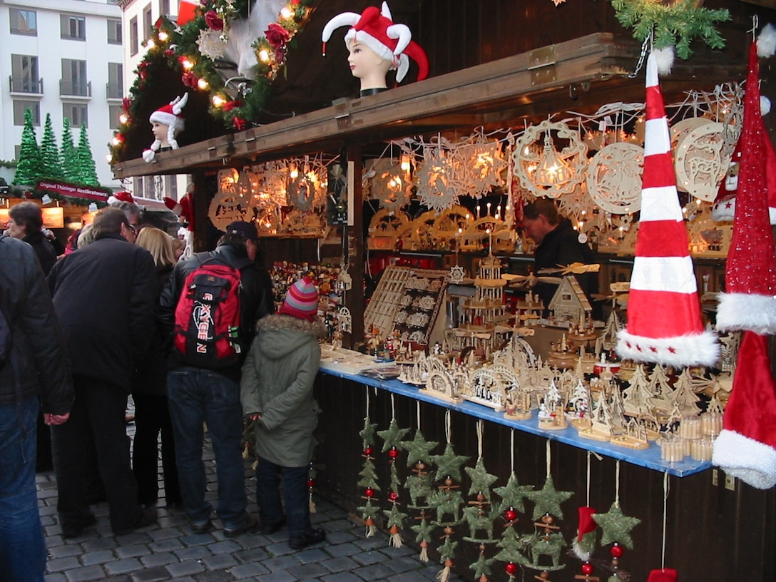 Shoppers enjoy local goods at a Christmas market in Leipzig, Germany. Leipzig is known for the Gewandhaus Orchestra, the Leipzig Opera and the hometown of Johann Sebastian Bach. (U.S. Air Force photo/1st Lt. Agneta Murnan)