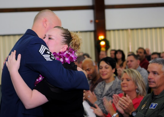 Alicia Mullinex embraces her father, former Command Chief Master Sgt. Allen Mullinex, during his retirement ceremony Dec. 3 at the Sunrise Conference Center. After an illustrious 25-year career, Chief Mullinex looks forward to completing his master's degree in business, snorkeling and learning how to dive. The outgoing command chief is being replaced by Chief Master Sgt. Margarita Overton, from the 78th Mission Support Group at Robins Air Force Base, Ga. (U.S. Air Force photo/ Senior Airman Nichelle Anderson)