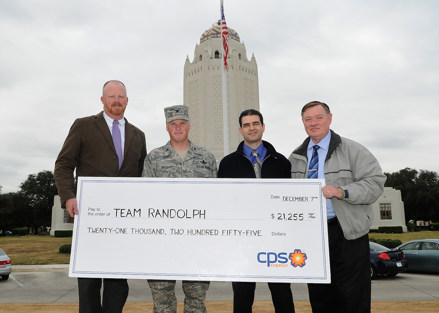 Randolph AFB, TX,2010/12/07:  A check for $21,255 is presented to Air Force representatives by John Barrow, Energy Solutions Manager CPS Energy. The check is a demand response energy credit for energy savings at the base. In the photo, from left, are Barrow, Colonel Scott Peel, 902nd Mission Support Group commander, Ruben D. Ramos Jr., Utilities Engineer 902nd Civil Engineers, and Jim Wimberley, Chief Asset Optimization, 902nd Civil Engineers.  (U.S. Air Force photo/Dave Terry)