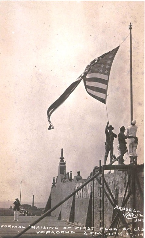 U.S. Navy and Marines raise flag over Veracruz, 1914.  (Courtesy of Wikipedia)