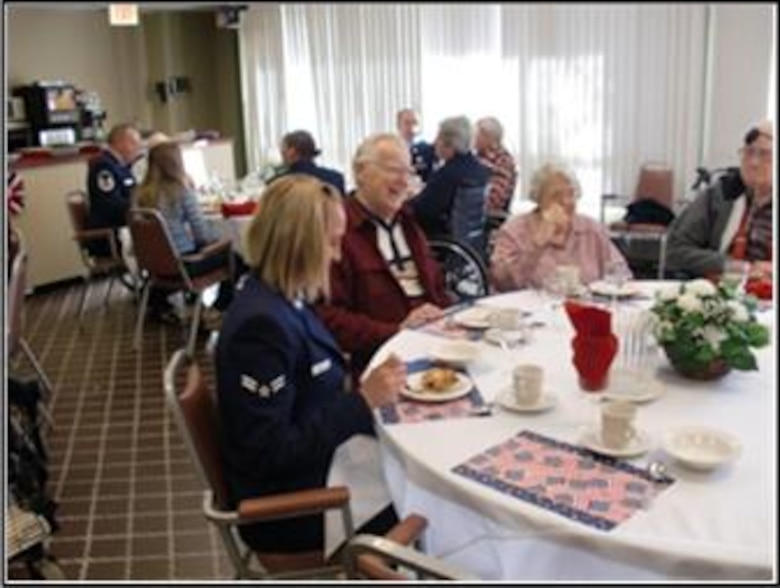 Airman 1st Class Michelle Saucier, 103rd Airlift Wing, talks with residents at the Little Sisters of the Poor residence home in Enfield, Conn. on Veterans Day, Nov. 11, 2010. The event was the brain child of Kathi Carney, Director of Activities for the home. She reached out through a mutual friend to Chief Master Sgt. Robert Zukauskas who then enlisted the help of six eager volunteers. (Photo courtesy of Chief Master Sgt. Robert Zukauskas)