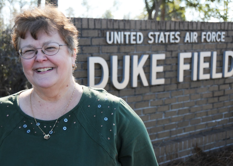 Ann Avant, the first female non-prior service enlisted Airman at Duke Field, Fla., put a career of nearly four decades of military and federal civilian service behind her as she retired Dec. 4.    The Defuniak Springs, Fla., native launched her career in 1972 when the base's 919th Special Operations Wing was in its infancy. (U.S. Air Force photo/Adam Duckworth)