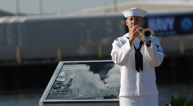 A Navy bugler plays taps during a commemoration ceremony at the Pearl Harbor Visitors Center at the World War II Valor in the Pacific National Monument Dec. 7, 2010. (U.S. Air Force photo by Staff Sgt. Carolyn Viss)