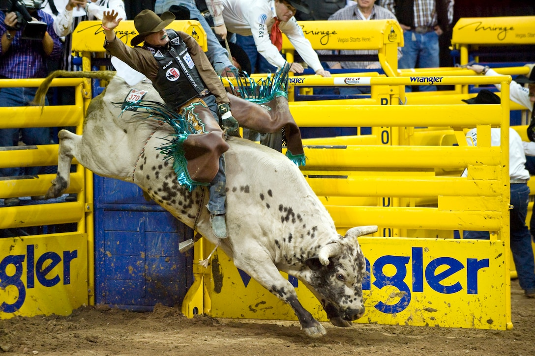 LAS VEGAS-- Bull rider Seth Glause from Rock Springs, Wyo., rides Texas Sancho during the fourth round of the National Finals Rodeo at the Thomas and Mack Center Dec. 5. (U.S. Air Force photo by Lawrence Crespo/Released)