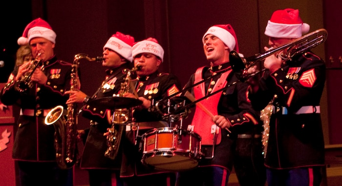 Members of the U.S. Marine Corps Forces, Pacific, Party Band perform and wow the audience Dec. 10 during the third annual Na Mele o na Keiki (Music for the Children) Holiday Concert at the Neal S. Blaisdell Concert Hall here. In addition to spreading holiday cheer and showing support for the community, members of the Marine Corps Reserve's Toys for Tots Program were on hand to accept donations for children in need living in Hawaii.