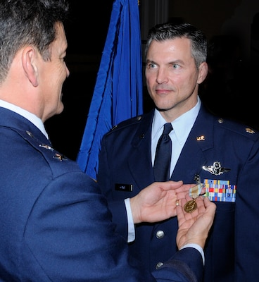Randolph AFB, TX, date shot:  20101010 (U.S. Air Force photo/ By Don Lindsey Major General Frank Padilla Commander, Tenth Air Force Air Force Reverve Command Joint Reserve Base Fort Worth, Texas presents the Airman's Medal to Lt. Col Richard L. Lowe, assigned to the 39th Flying Training Squadron at a ceremony  held at Randolph AFB theater on December 10, 2010.  Lt. Col Lowe distinguished himself by heroism involving voluntary risk of life following the crash of Flight 1404 at Denver International Airport on 20 December 2008.