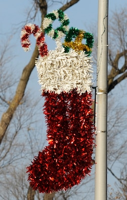 A stocking decoration is hung on a street light on Scott Drive Dec. 10.  Scott Air Force Base takes pride in decorating for the holiday season. (U.S. Air Force photo/ Staff Sgt. Ryan Crane)