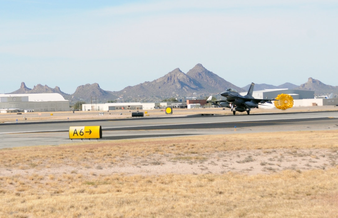A Royal Netherland's Air Force F-16 assigned to the Arizona Air National Guard's 162nd Fighter Wing at Tucson International Airport lands here Friday, Dec. 10, using a drag chute. Chutes are typically employed by Dutch fighters as a safety feature for short field landings and adverse weather conditions. They can reduce the needed runway length by nearly 50 percent. U.S.-owned F-16s at the airport don't use drag chutes, making this type of landing unique to the Dutch pilot training program here. (U.S. Air Force photo/Maj. Gabe Johnson)