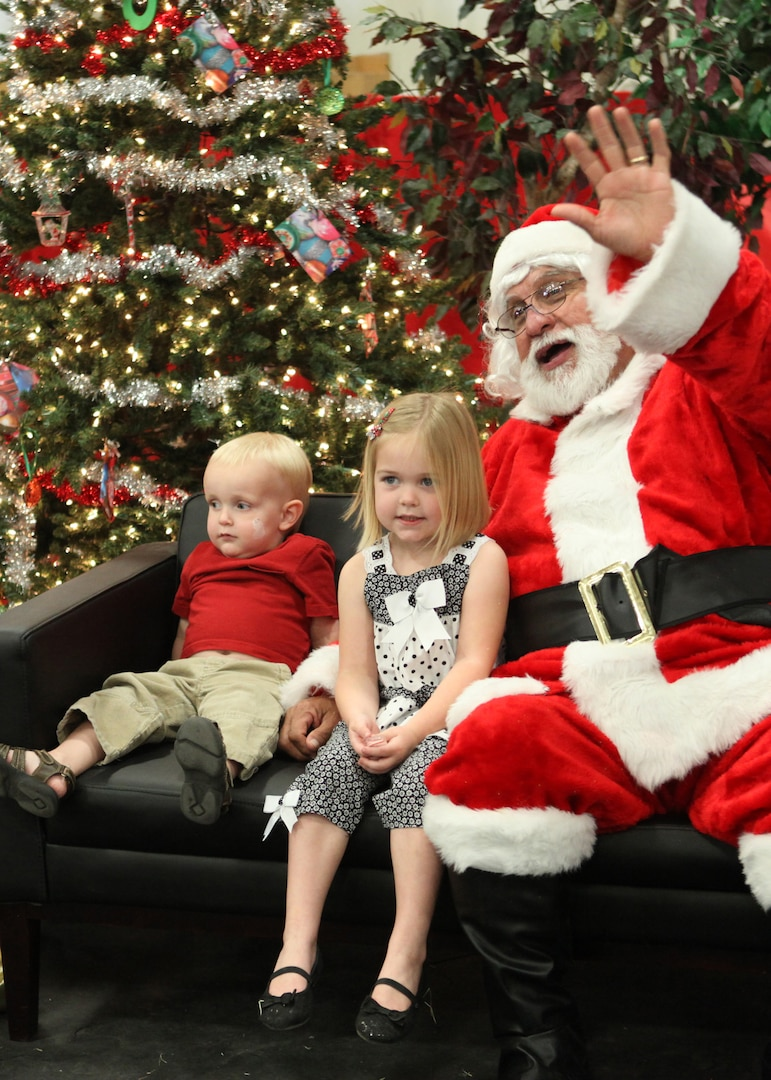 Tristan and Lexi Riley, children of Tech. Sgt. Kenneth Riley, 342nd Training Squadron, have their photo taken with Santa during the Children's Holiday Party Dec. 4. (U.S. Air Force photo/Robbin Cresswell)