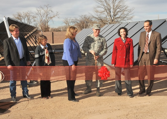 From left, Glenn Gallipoli, 310 Solar, Sarah Cobb, representing Sen. Tom Udall, Christy Smith, 377th Mission Support Group Civil Engineer Division, Chugach Task Order Project Manager, Col. Robert L. Maness, 377th Air Base Wing commander, Jessica Perez, representing Sen. Jeff Bingaman, and Antonio Sandoval, staff member for Rep. Martin Heinrich, attend the ribbon-cutting ceremony for the new solar thermal system at the indoor pool.