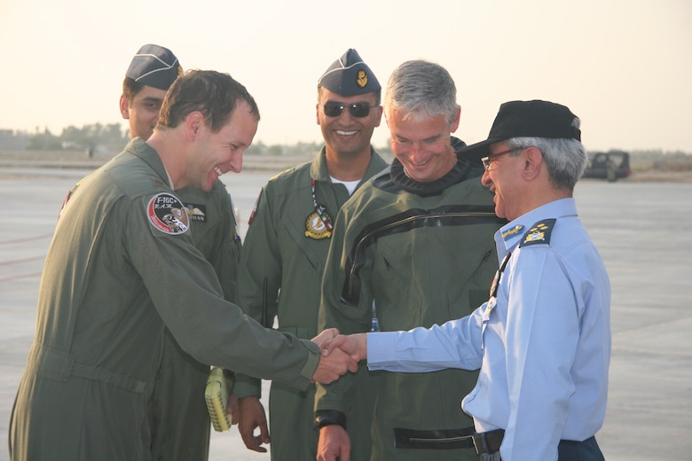 Maj. Bart Van Roo shake shands with Air Marshal Mohammad Hassan, PAF Deputy  Chief of Staff for Operations on October 30, 2010, after delivering one of three new F-16s to the Pakistani Air Force.  Lt. Col. Doug Read (second from right) and Maj. Chris Hansen delivered two more F-16s the same day.